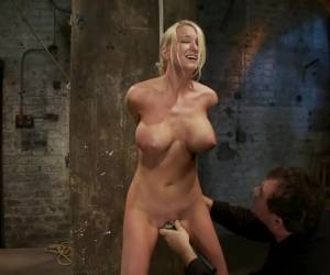 Bomb shell blond with massive breasts, tan, long sexy legs gets bound, crotch roped and made to cum