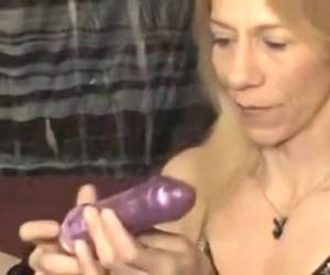Mature lady swallows dildo as if it were a swords is